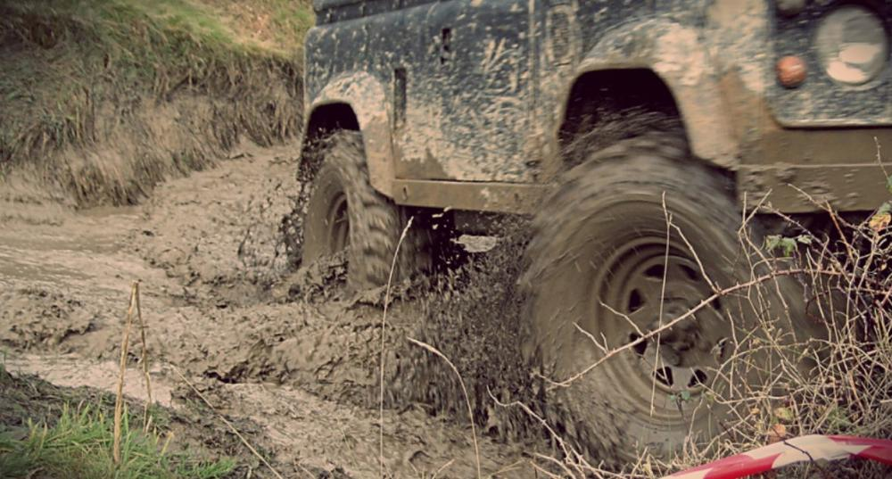 photo of vehicle driving in mud