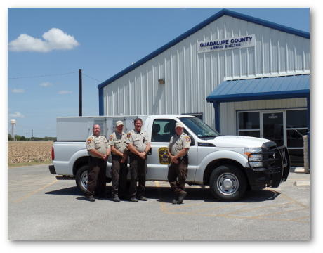 Animal control division pose next to their truck.