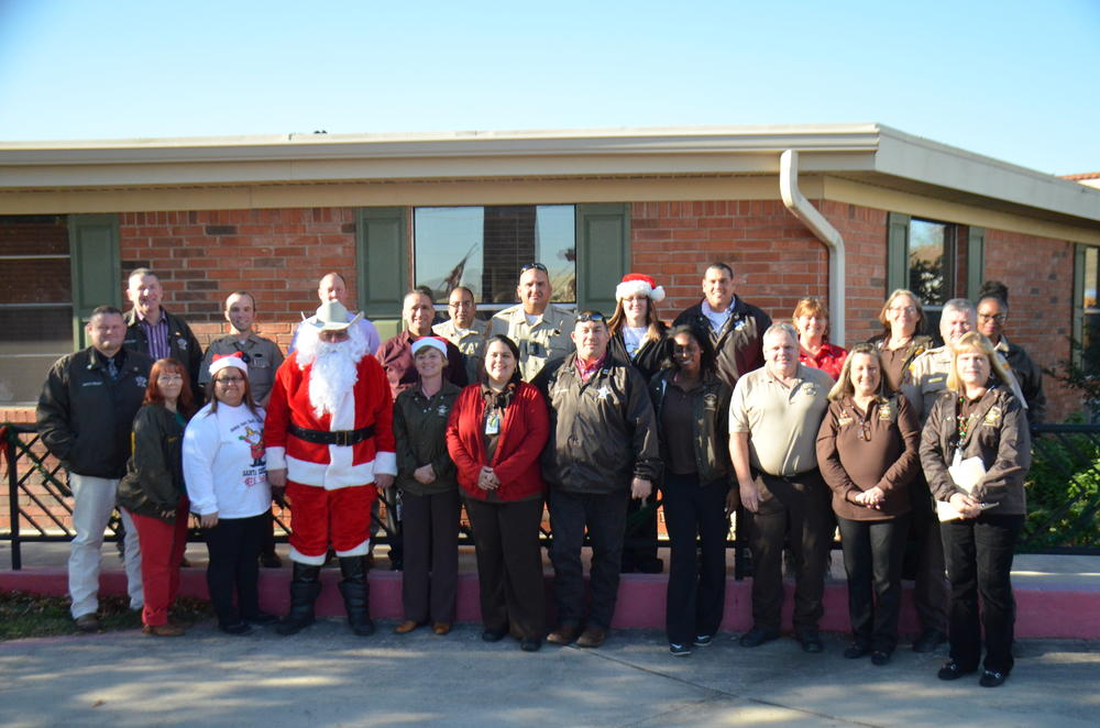 Sheriff's office staff photo for their annual Santa Sheriff event