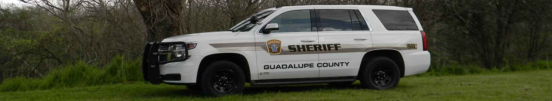 A side view of Guadalupe County sheriff's patrol car.